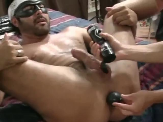 Masked hunky homo gets his tight ass stretched with a big dildo