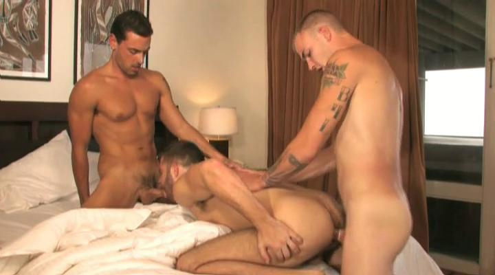 Three tanned and tattooed homosexual guys having trio in the abode