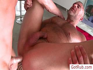 Muscled guy getting his ramrod rubbed by gotrub