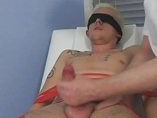Bound and blindfolded golden-haired twink receives his cock sucked by aged homosexual dad
