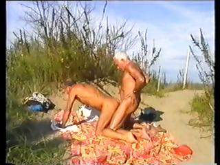 Concupiscent homosexual silver foxes play with every others cock at the beach