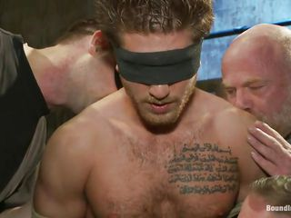 Looks like this stud with tattoo in his chest has upset many gay dudes. And they all receive him for these reasons. See how this chab is blindfolded and tied in a public place, naked. Moreover, they are punishing him: jerking his cock, giving him blowjob, making him to engulf cocks. Looks like they'll drill his wazoo too!