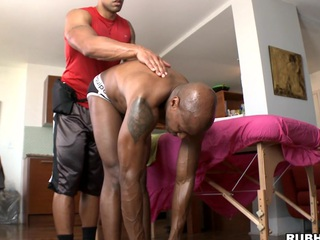 Chocolate chap is getting nice oil massage and large pecker in his a-hole